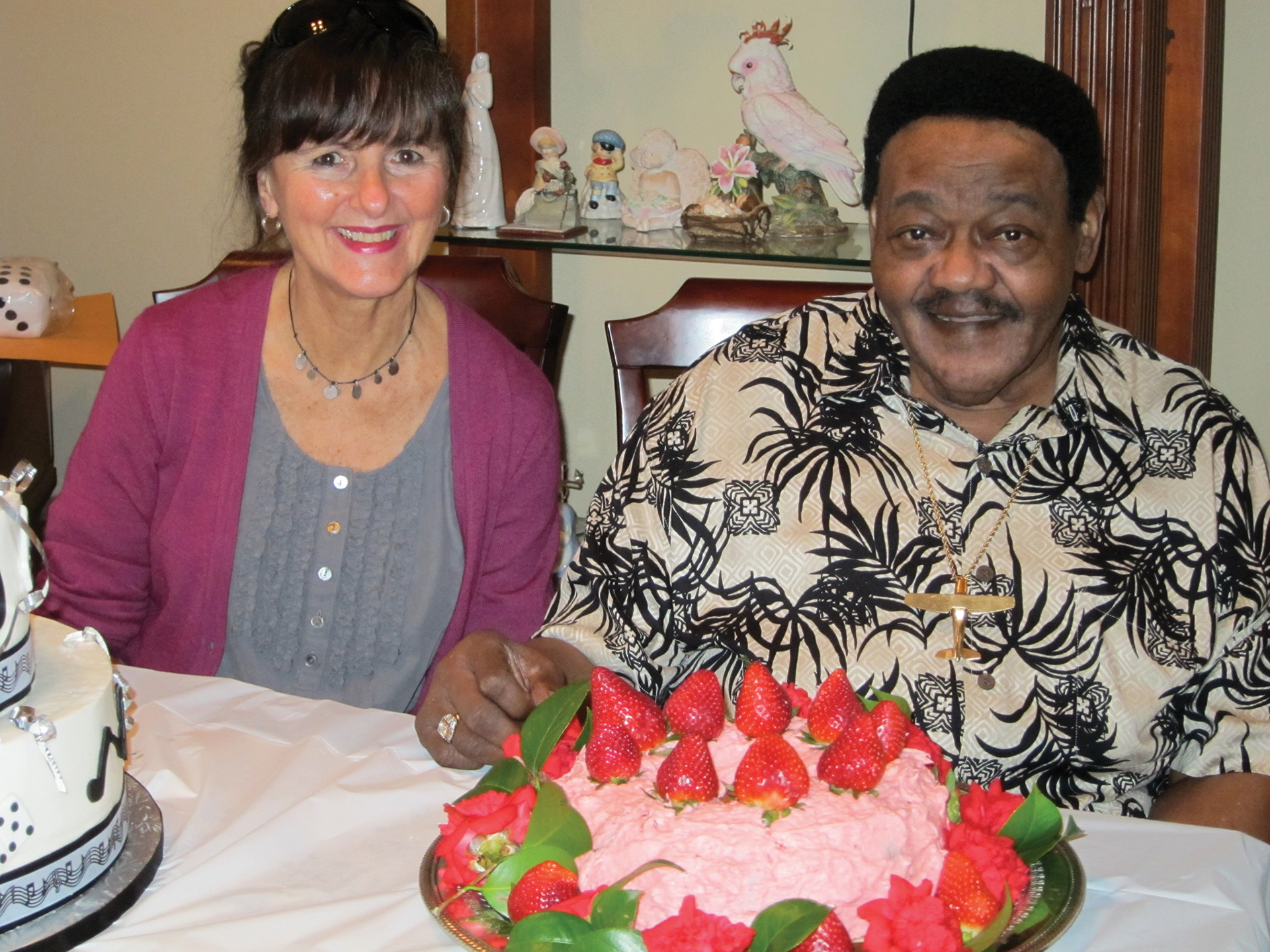 Haydee Ellis, and the legendary Fats Domino with his birthday strawberry cake, wearing his ever-present smile.